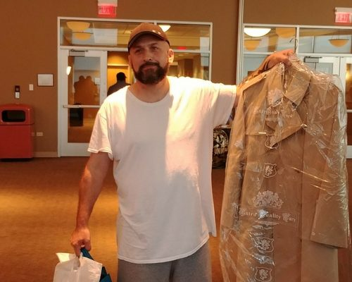 Returning citizen won this coat in our raffle!
